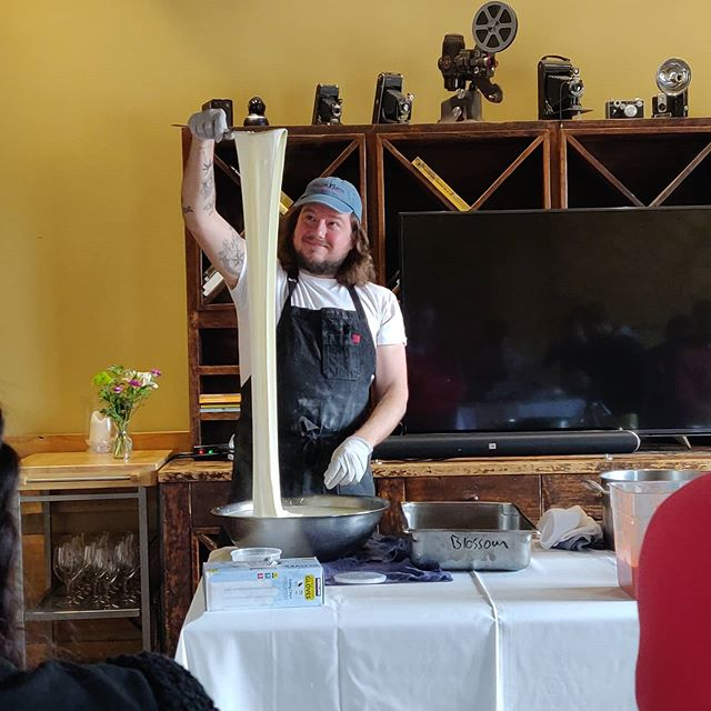 Anthony Falco displaying his skills in fresh mozzarella